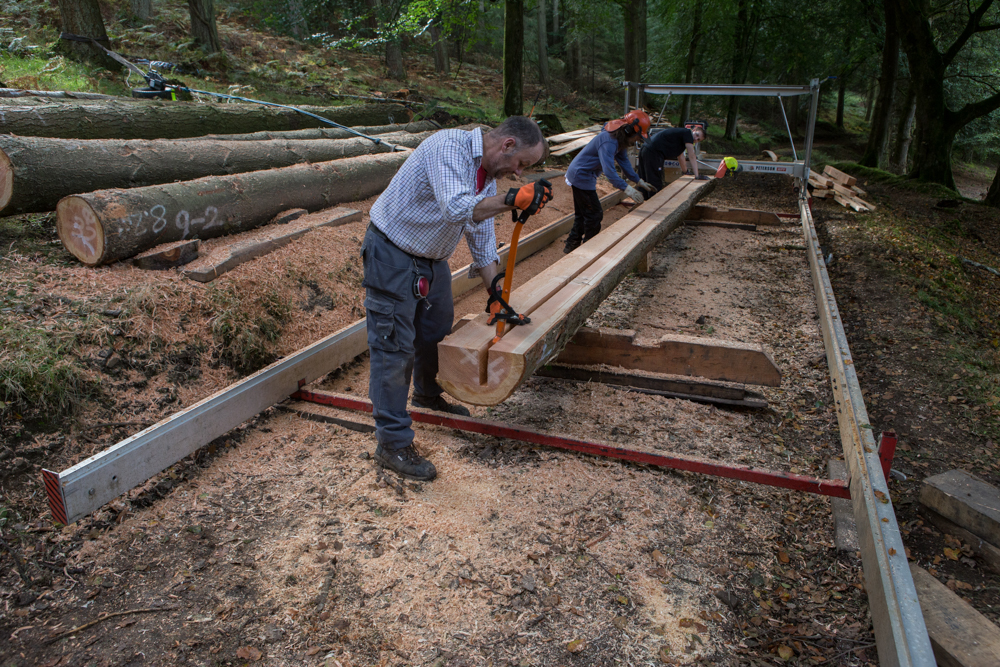 Removing freshly sawn beam from log